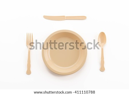 plastic plate spoon fork and knife on white background - stock photo