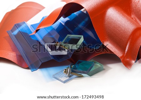 Plastic products made �¢??�¢??of polycarbonate and acrylic roof and screws for fixing - stock photo