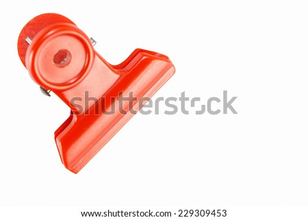 Plastic red bulldog clip isolate on white