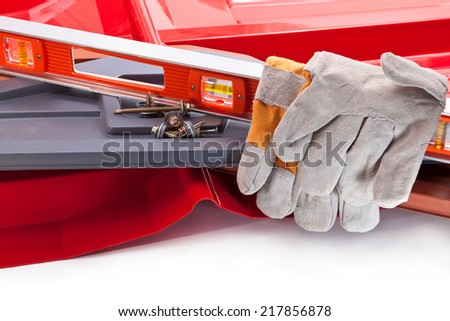 Plastic roof, level, gloves and screws for mounting - stock photo