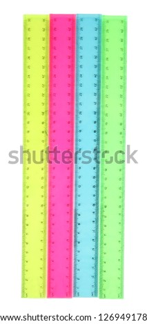 Plastic rulers isolated on white - stock photo