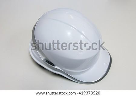 Plastic safety helmet on white background - stock photo