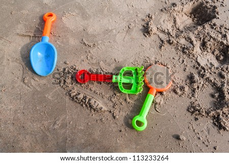 Plastic sandbox on the beach, kid playground - stock photo
