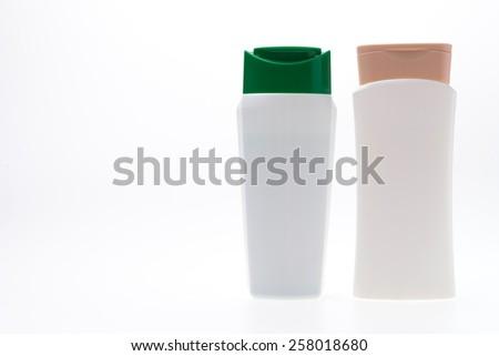 Plastic shampoo bottles isolated on white background - stock photo