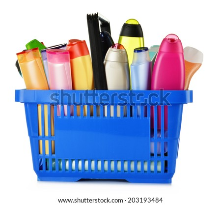 Plastic shopping basket with plastic bottles of body care and beauty products  - stock photo
