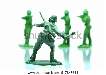 Plastic soldier toy isolated on white background.