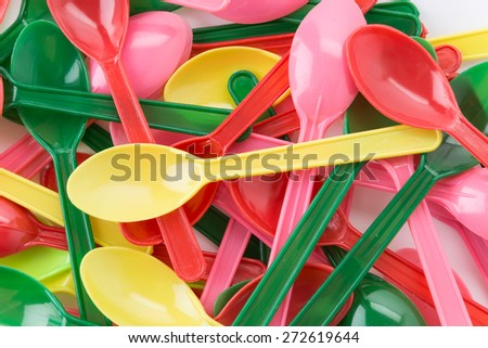 plastic spoon on white background - stock photo