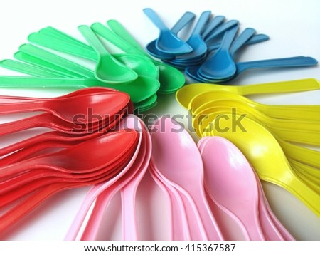 plastic spoons on white background