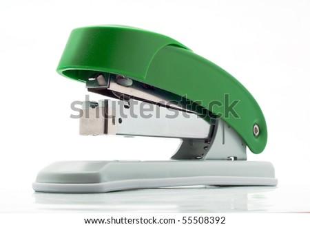 plastic stapler green white background - stock photo