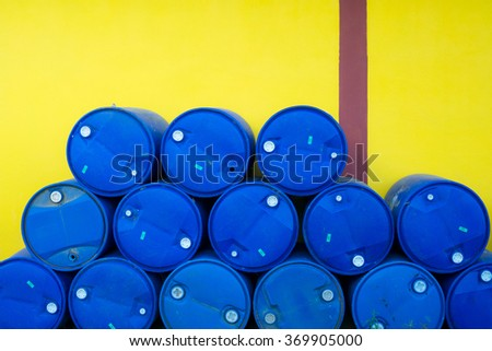 Plastic Storage Drum, Blue Barrel. Isolated on yellow wall background - stock photo