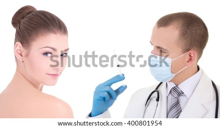 plastic surgery - doctor in mask and blue gloves with syringe and woman patient isolated on white background - stock photo