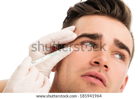 Plastic surgery. Handsome man on a white background - stock photo