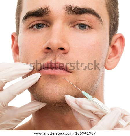 Plastic surgery. Handsome man on a white background