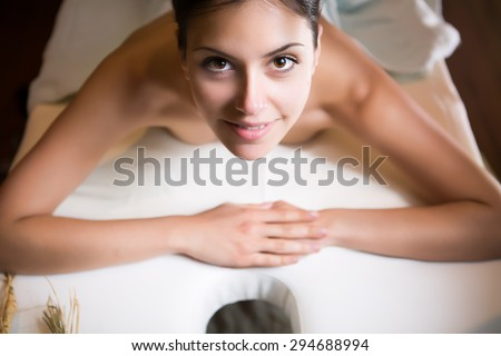Plastic surgery,liposuction and cellulite removal concept.Spa woman wrapped in towels.Skincare.Perfect young exfoliated skin.Woman having body massage happy with the beauty treatment results - stock photo