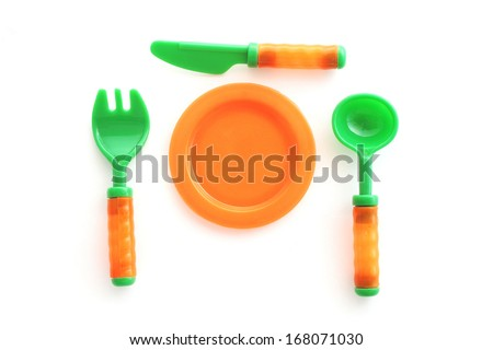 plastic tableware toys on white background - stock photo