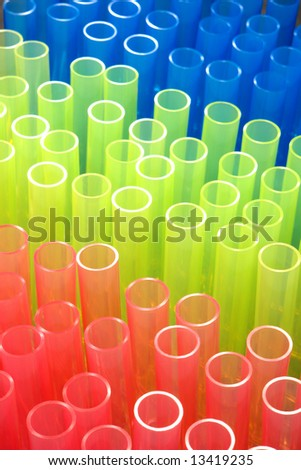 Plastic test tubes in rainbow colors in a science research lab  - stock photo