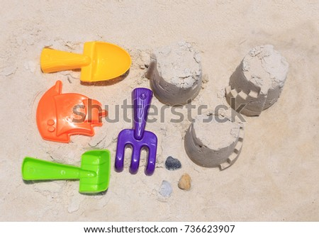 Plastic tools used for making sand castles on the beach.