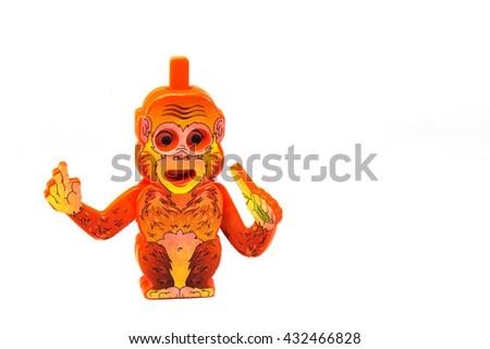 Plastic Toy Animal, funny monkey with banana isolated on a white background - stock photo