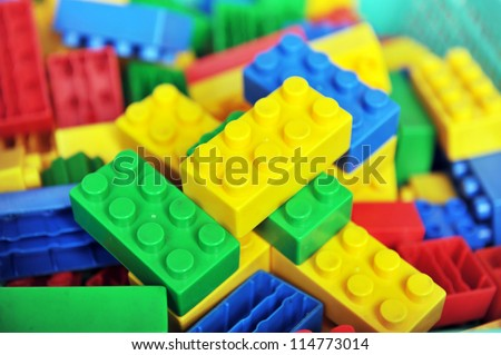 Plastic toy blocks on white background - stock photo