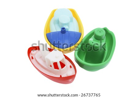 Plastic Toy Boats on White Background