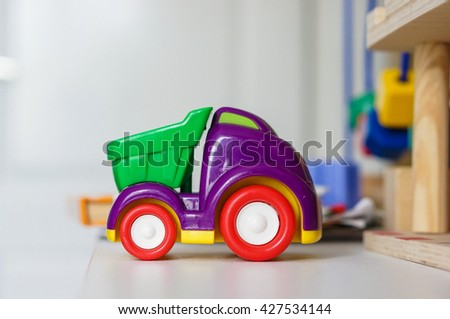 Plastic toy car on table - stock photo