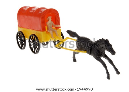 plastic toy frontier wagon with horse - stock photo