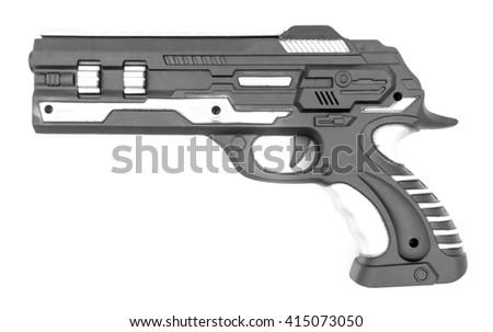 Plastic toy gun on white - stock photo