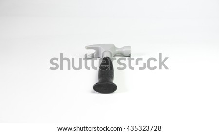 Plastic toy hammer with black handle. Isolated on empty background. Slightly de-focused and close-up shot. Copy space.
