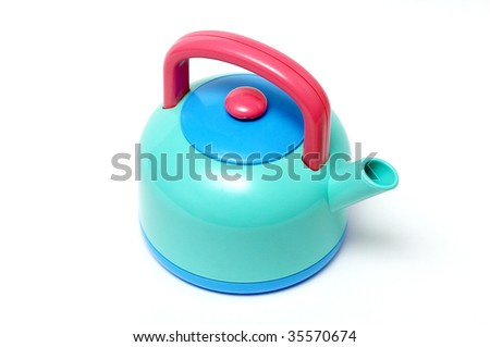 Plastic toy tea-pot isolated over white background macro shot