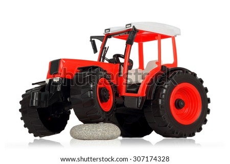 plastic toy tractor isolated on white background