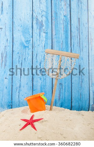 Plastic toys at the summer beach - stock photo