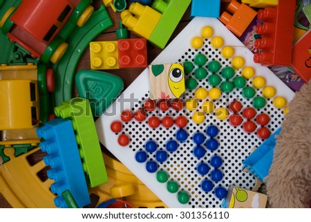 plastic toys on a wooden base - stock photo