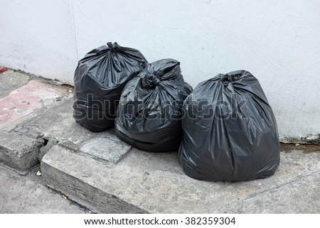 Plastic trash bags on outside street office - stock photo