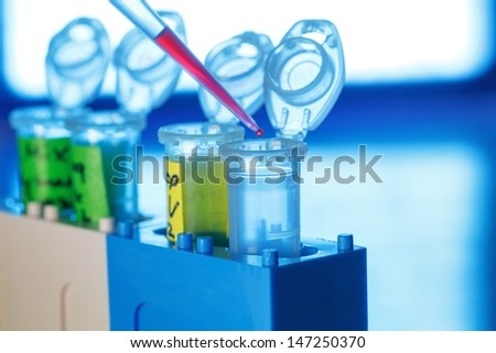 Plastic tubes and pipette - stock photo