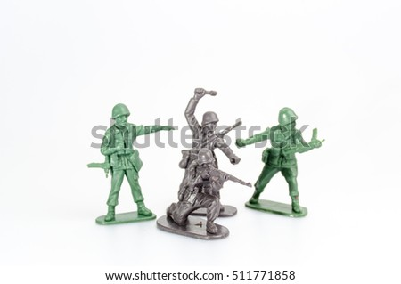 Plastic war of mini toy soldiers on white