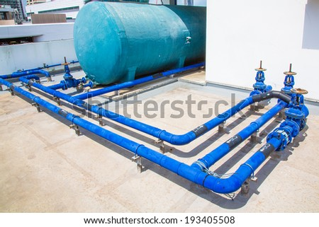 Plastic water tank and Water pipeline Building on the deck - stock photo
