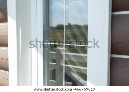 Plastic white window muntin bars with the reflection of the blue cloudy sky with green trees & Plastic White Window Muntin Bars Reflection Stock Photo 466769819 ...