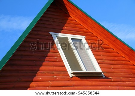 Plastic window of a modern summer cottage against a blue sky