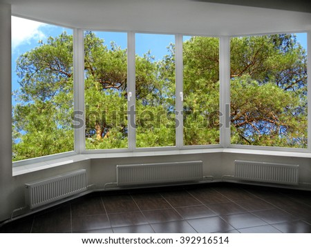 plastic windows overlooking the green branches of pine