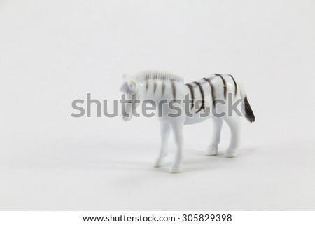 Plastic zebra toy on a white background - stock photo