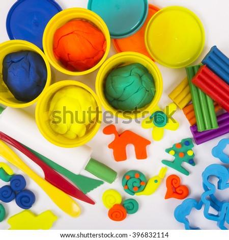 Plasticine and tools - stock photo