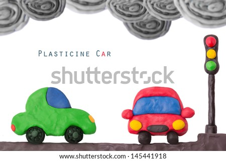 Plasticine car and traffic llight on a not ecology exhaust smog - stock photo