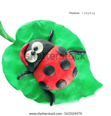 Plasticine cartoon ladybug seeting on a green leaf on a white background - stock photo