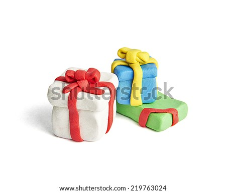 Plasticine clay present boxes isolated on white - stock photo