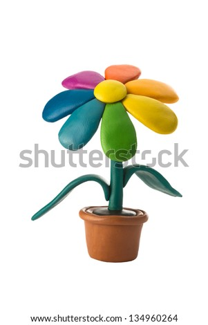 Plasticine colorful flower in a brown pot - stock photo