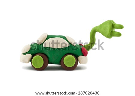 plasticine electric car isolated on white background - stock photo