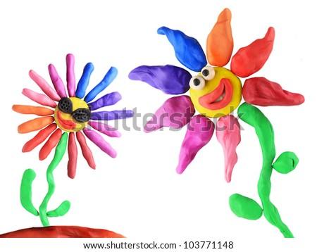 plasticine flowers friendship on the white background - stock photo