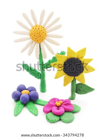 Plasticine flowers isolated on a white background. - stock photo