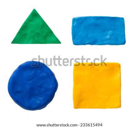 Plasticine  geometric shapes isolated on white - stock photo