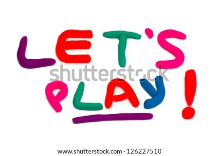 "plasticine ""let's play"" phrase over white - stock photo"